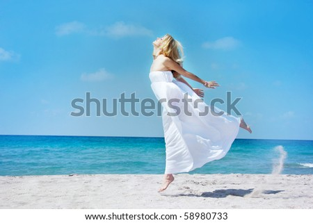 jumping girl on sea background - stock photo