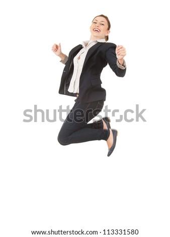 jumping happy businesswoman in dark jacket, full length, white background - stock photo