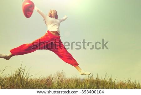 Jumping happy girl - stock photo