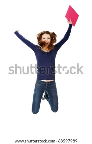 Jumping happy teen student girl, isolated on white background - stock photo