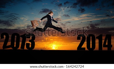 jumping into new year - stock photo