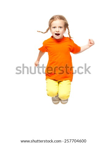 Jumping little child. Girl isolated on white