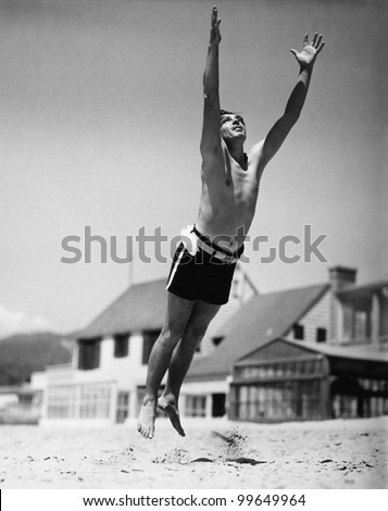Jumping man in midair - stock photo