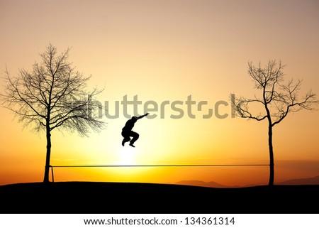 jumping on slackline - stock photo