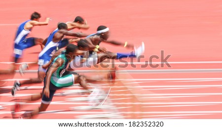 Jumping over hurdles, motion blur - stock photo