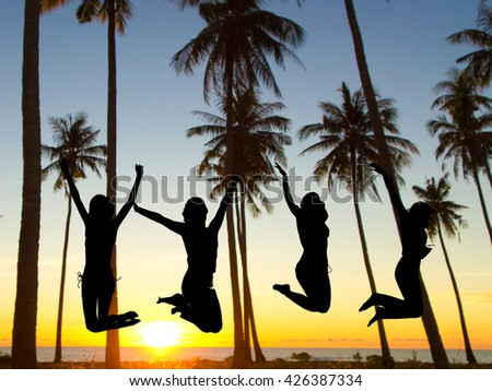 Jumping over Sunset Dance the Night Away  - stock photo