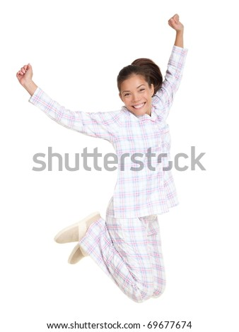 Jumping pajamas woman morning fresh and cheerful. Isolated on white background in full body. Mixed race Asian / Caucasian female model. - stock photo