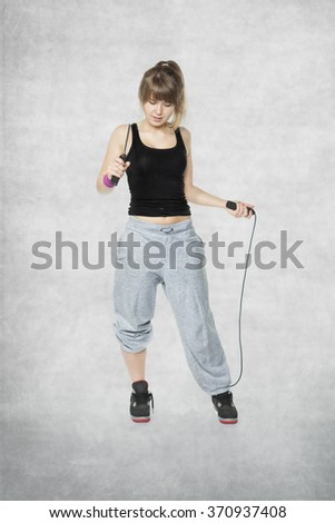 jumping rope is good fun - stock photo