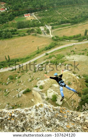 Jumping rope with a rock. - stock photo