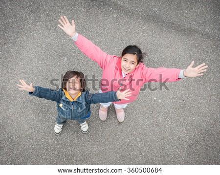 Jumping running kid on the street - stock photo