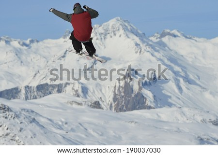 jumping skier at mountain winter snow fresh suny day