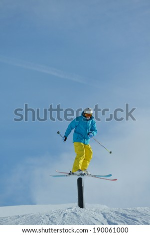 jumping skier at mountain winter snow fresh suny day - stock photo