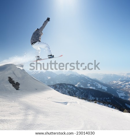 Jumping snowboard - stock photo