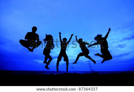 jumping team as silouette - stock photo