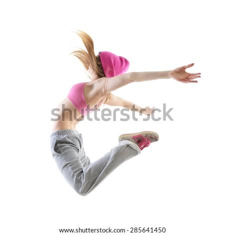 Jumping teen girl hip-hop dancer over white background - stock photo