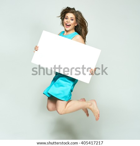 Jumping woman holding white sign board. isolated portrait.