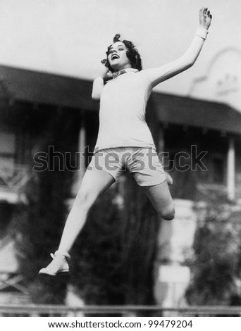 Jumping woman in midair - stock photo