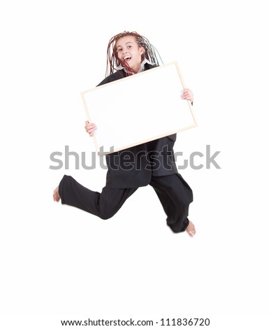 jumping woman in too big suit with blank sign, full length, white background - stock photo