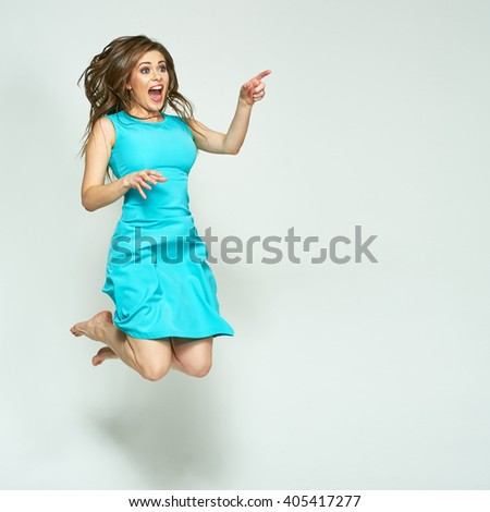 Jumping woman isolated portrait. Finger pointing on copy space.
