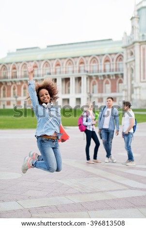 Jumping young girl outdoors - stock photo