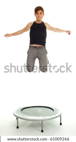 jumping young handsome man on the trampoline, white background