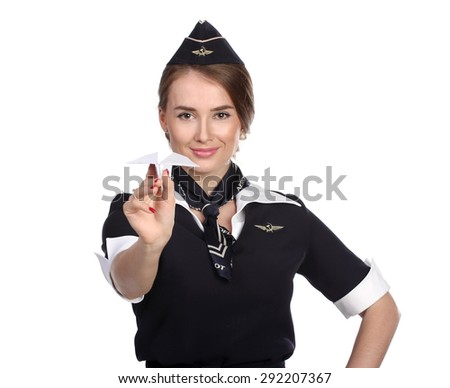 JUN 31, 2015 Air hostess in new uniform of national Russian airline Aeroflot, skyteam member. Holding Paper Plane In Hand.