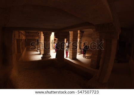 JUNAGADH, INDIA - JANUARY 4: Visitors make pictures in ancient buddhist cave of Uparkot Fort on January 4, 2016 in Junagadh