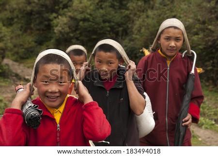 JUNBESI, NEPAL - CIRCA OCTOBER 2013: follower monks to the monastery circa October 2013 in Junbesi. - stock photo