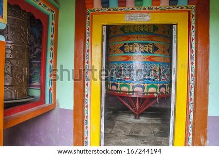 JUNBESI, NEPAL - CIRCA OCTOBER 2013: prayer wheel circa October 2013 in Junbesi. - stock photo