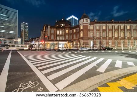 Junction at Marunouchi Tokyo Station at night - stock photo
