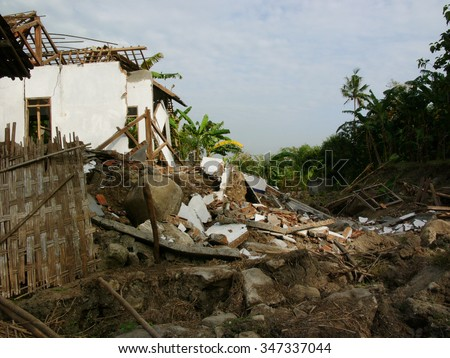 June 22, 2006: A house lies in ruins after the May 29 2006 earthquake measuring 5,7 on the Richter Scale devastated Central Java, on June 22, 2006 in Yogyakarta Province, Java, Indonesia. - stock photo