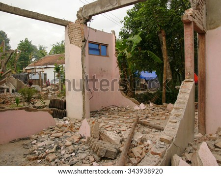 June 17, 2006: A house lies wrecked after the May 29 2006 earthquake measuring 5,7 on the Richter Scale struck Central Java, on June 17, 2006 in Yogyakarta Province, Java, Indonesia. - stock photo