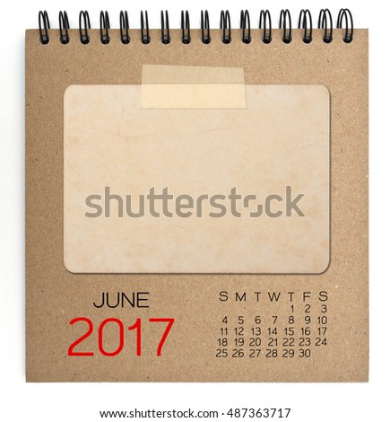 June 2017 calendar on brown notebook with old blank photo