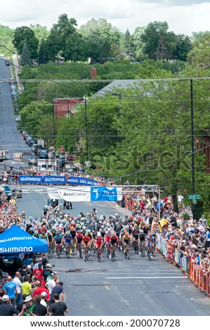 JUNE 15, 2014: Cyclists begin final stage of 2014 North Star Grand Prix in Stillwater, Minnesota. About 300 top pro cyclists from around the world compete in the prestigious event.  - stock photo