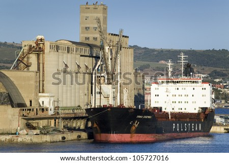 JUNE 2007 - Grain silos and cargo ship at Port of Civitavecchia, Italy, the Port of Rome