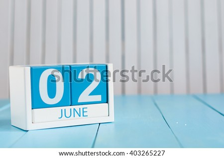 June 2nd. Image of june 2 wooden color calendar on white background.  Summer day, empty space for text