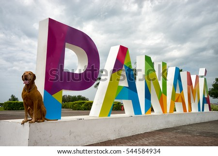 June 23, 2016 Panama City, Panama: the Panama sign on the Cinta Costera way in downtown with a Vizsla dog sitting on the base of it