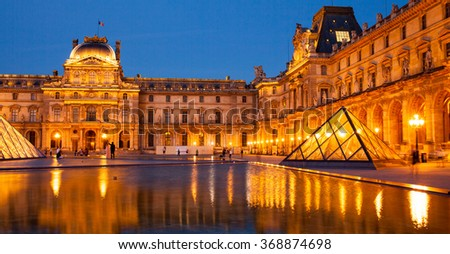 JUNE 28, 2015 - PARIS, FRANCE: Louvre in Paris with Pyramid and night lights. Paris, France. Letter box format.