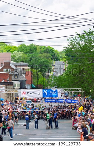 JUNE 15, 2014: Pro cyclists line up for start of stage six of 2014 North Star Grand Prix in Stillwater, Minnesota. Nearly 300 top pro cyclists from around the world compete in this prestigious event.