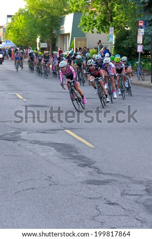 JUNE 13, 2014: Pro cyclists turn corner at stage four of 2014 North Star Grand Prix in Minneapolis, Minnesota. Nearly 300 top pro cyclists from around the world compete in this prestigious event.