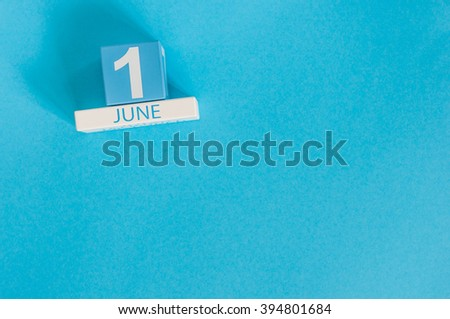 June 1st. Image of june 1 wooden color calendar on blue background.  First summer day. Empty space for text. Happy Childrens Day - stock photo