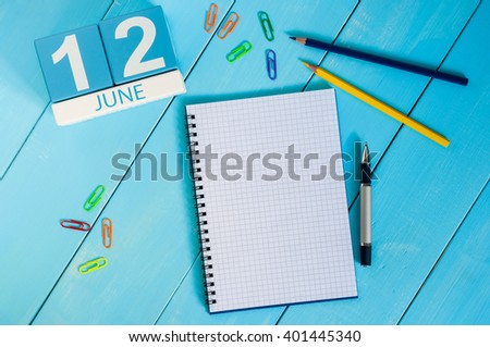 June 12th. Image of june 12 wooden color calendar on blue background. Summer day. Empty space for text - stock photo
