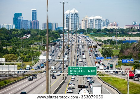 June 18th 2015, Toronto CANADA. 401 King's Highway is one of the largest Speedway in the World. View from an overpass with Toronto city in Background. - stock photo