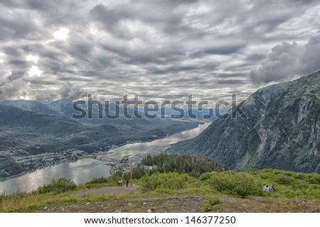 Juneau aerial view in cludy sky background - stock photo