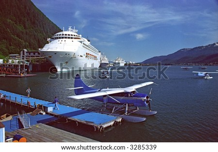 juneau alaska harbor with cruise ships and seaplanes - stock photo