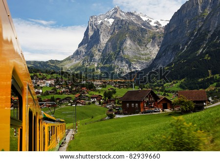Jungfrau Bahn over Grindelwald Village, Switzerland - stock photo