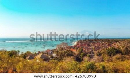 Jungutbatu Village with Mount Agung in the Background, Lembongan, Indonesia - stock photo