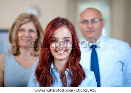 Junior and senior business colleagues work together, business team shoot - stock photo