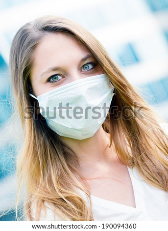 Junior executives dynamics  wearing protective face mask against pollution - stock photo