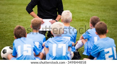 junior football soccer team with soccer coach and training, tactic board - stock photo